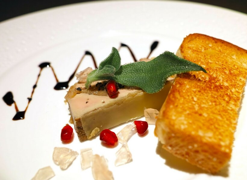 dish or foie gras with toast and red berries