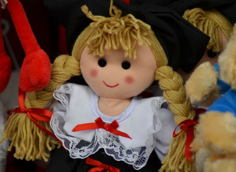 christmas doll: girl with braided blond hair