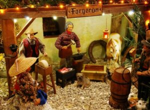 santons representing an old forge, a dog, a horse, and two other workers