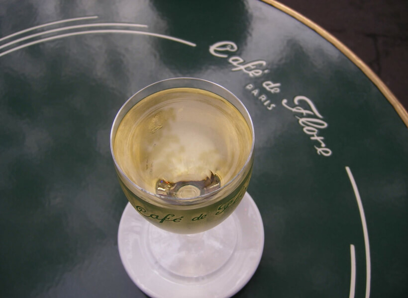 café de flore table and glass of white wine