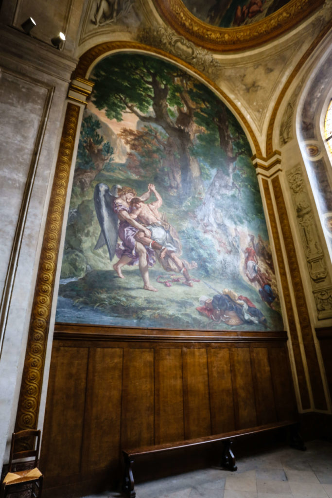 delacroix painting at the saint sulpice church in paris showing Michael slaying the dragon