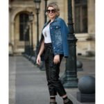 Woman dressed with leather black pants, a jean jacket and sun glasses: how to look stylish in paris episode
