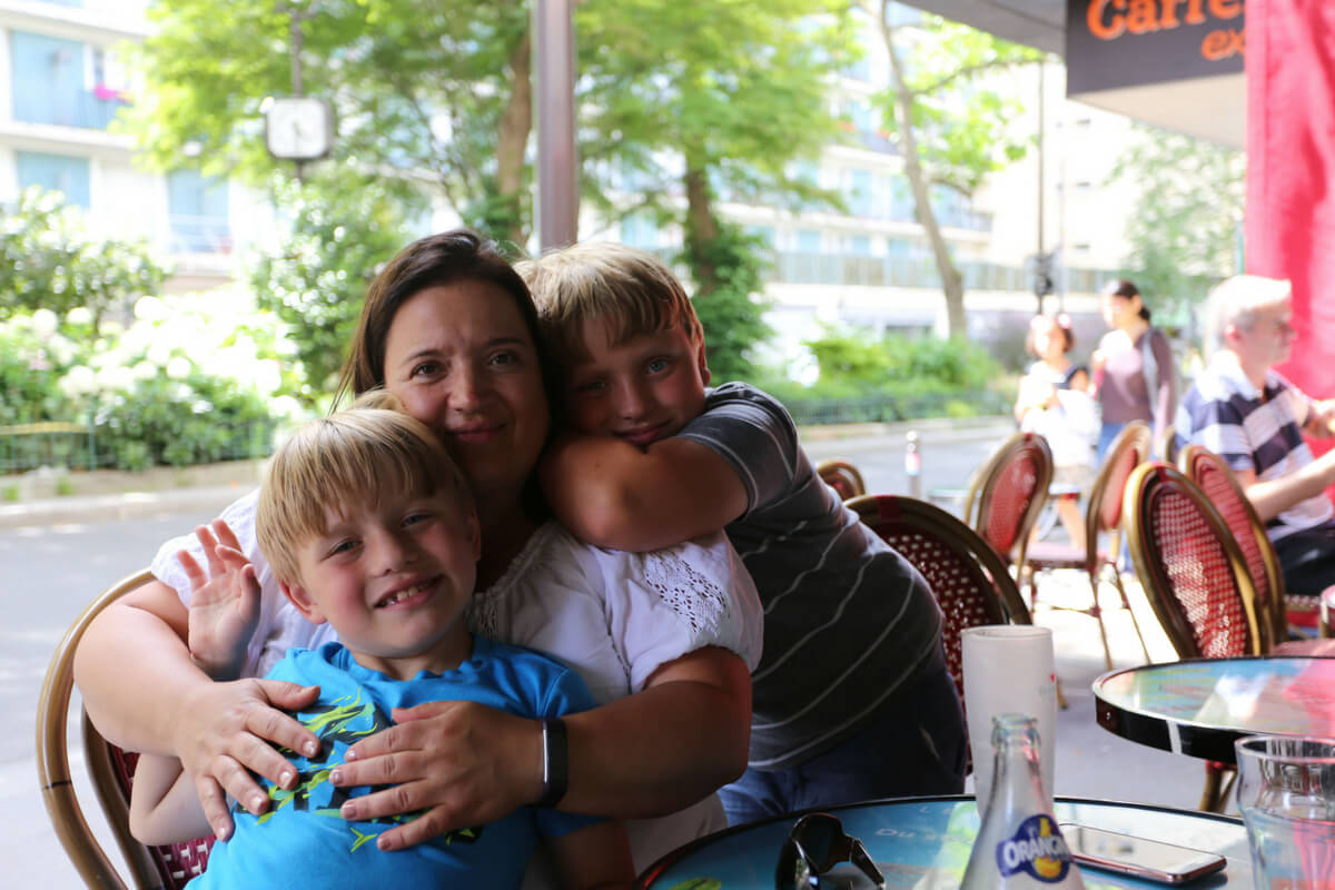 Jeanne, Luke and Max at a Paris café: Paris with Boys 7 and 10