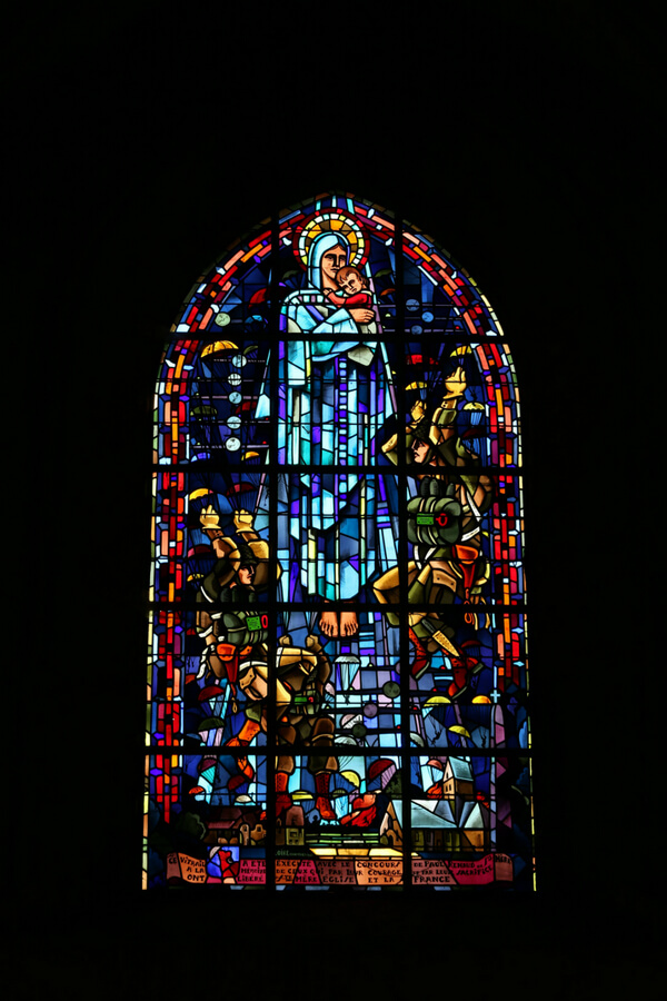 stained-glass window that depicts a paratrooper on D-Day