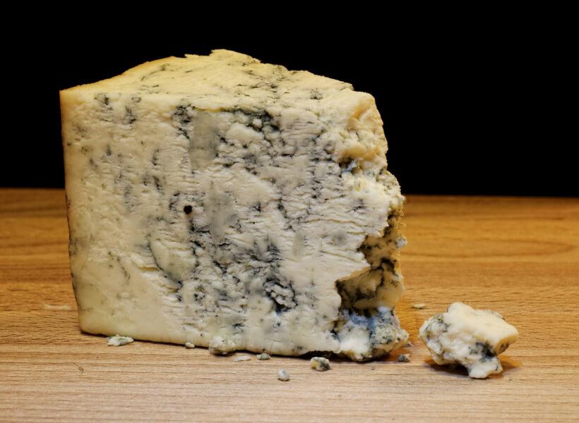 Roquefort cheese on a wooden platter