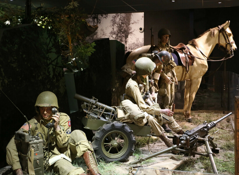 Museum display that shows men, guns and a horse in action during Operation Overlord