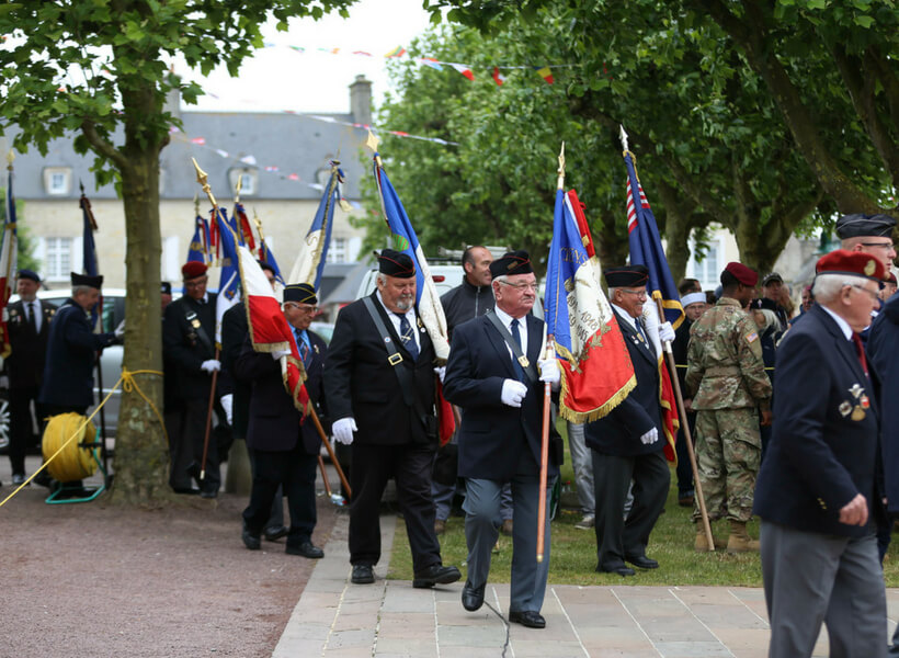 Officials at a commemoration ceremony at Sainte-Mère-Église