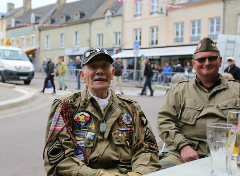 Veteran visiting Normandy to celebrate D-Day 2018 sitting at a café in Sainte-Mère-Église