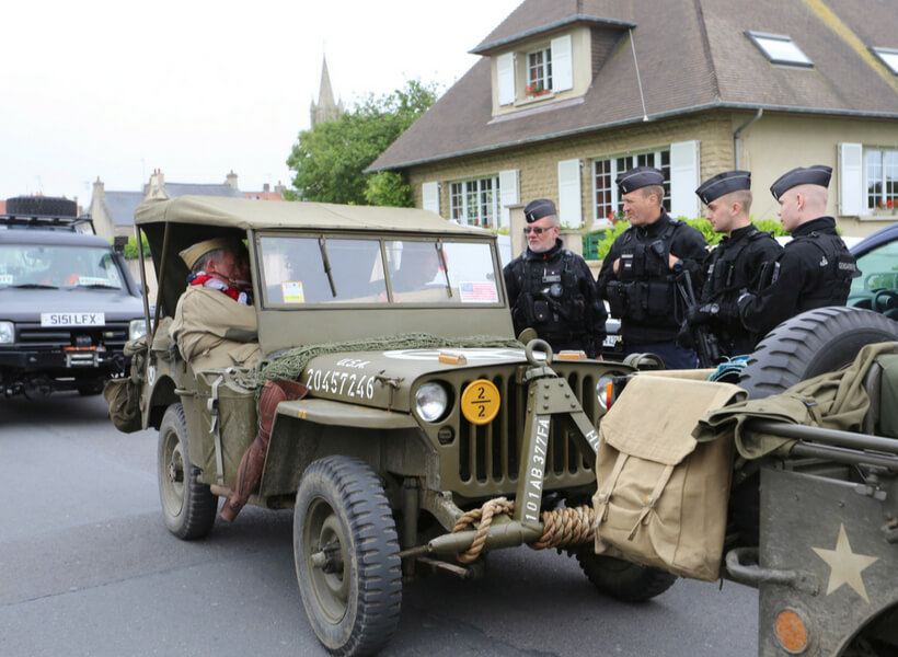 Operation Overlord reemactors chat with French police in Arromanches-sur-Mer
