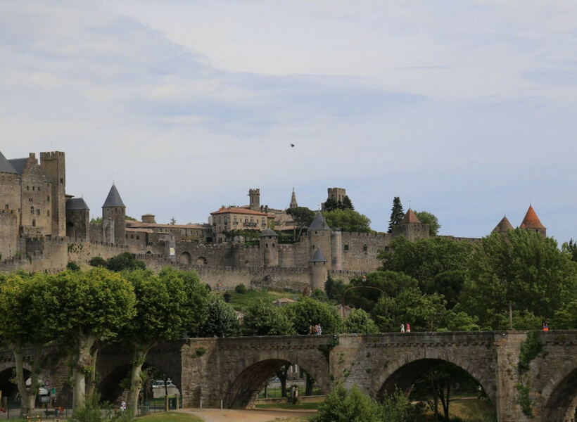view of the walled city of carcassonne seen from the outside