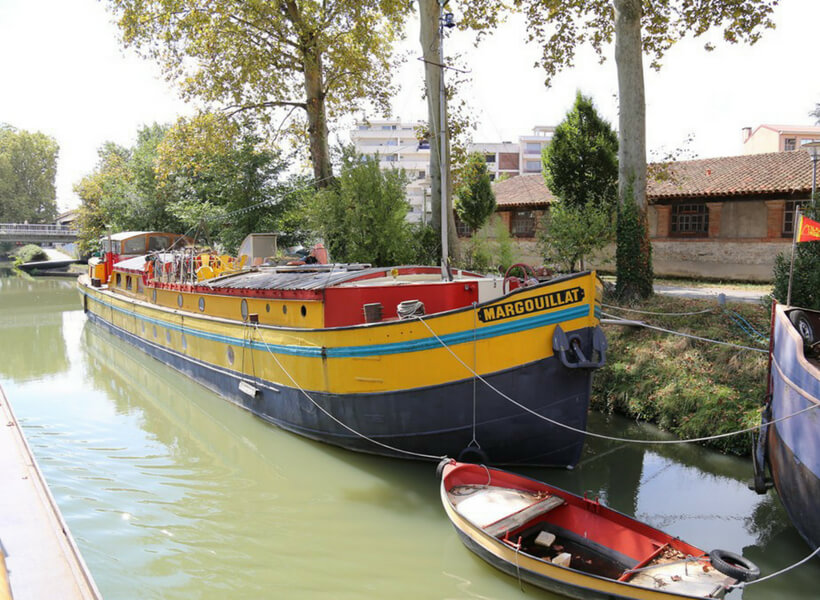 colorful barges parked along the canal du midi
