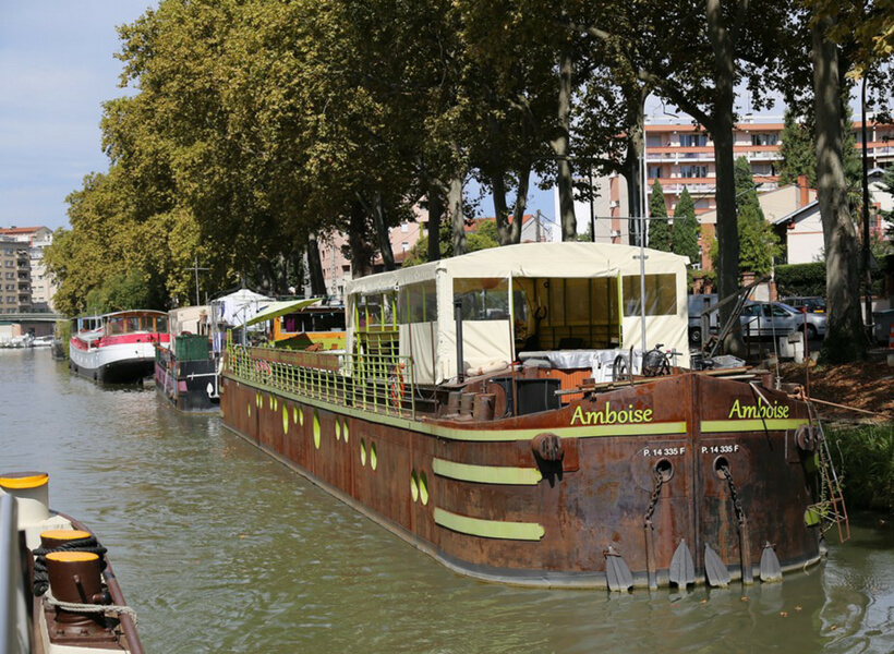 barges parked along the canal du midi in Toulouse