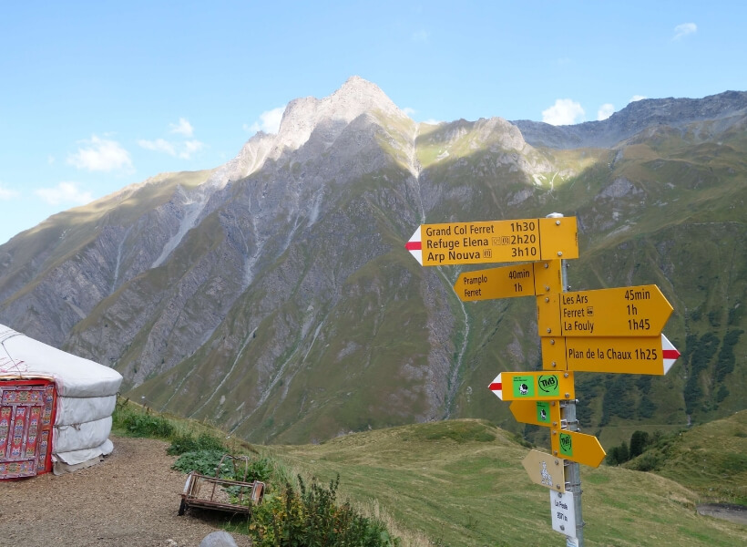 signs along the tour du mont blanc that indicate how long it will take to get to various destinations