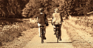 two retired women riding their bicycles in the French countryside