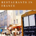 Blackboard menu and restaurant terrasse in the background