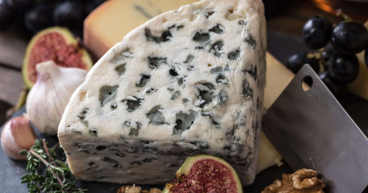 platter of french cheese inclusing roquefort and morbier
