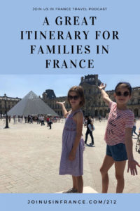 Sarah's twin daughters posing in front of the Louvre glass pyramid