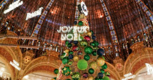 2018 Christmas tree at the Galeries Lafayette Haussmann and sign that says Joyeux Noel