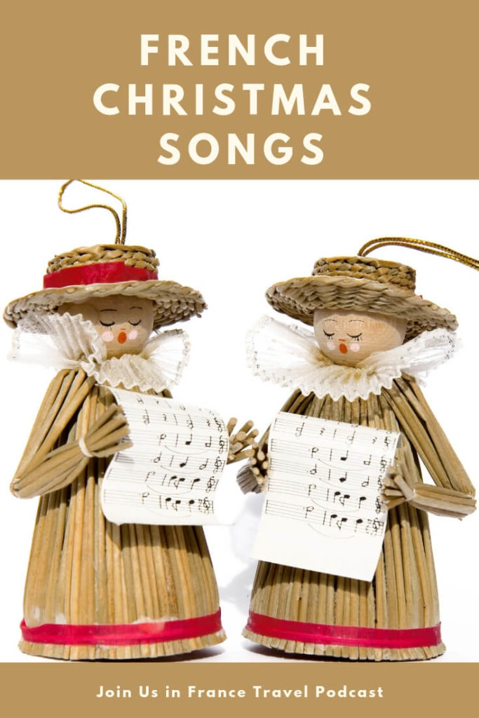 Christmas ornaments made of straw holding sheet music and singing French Christmas Songs