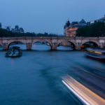 Seine River at sunset with light streaks from boats. 4 days in Paris episode.
