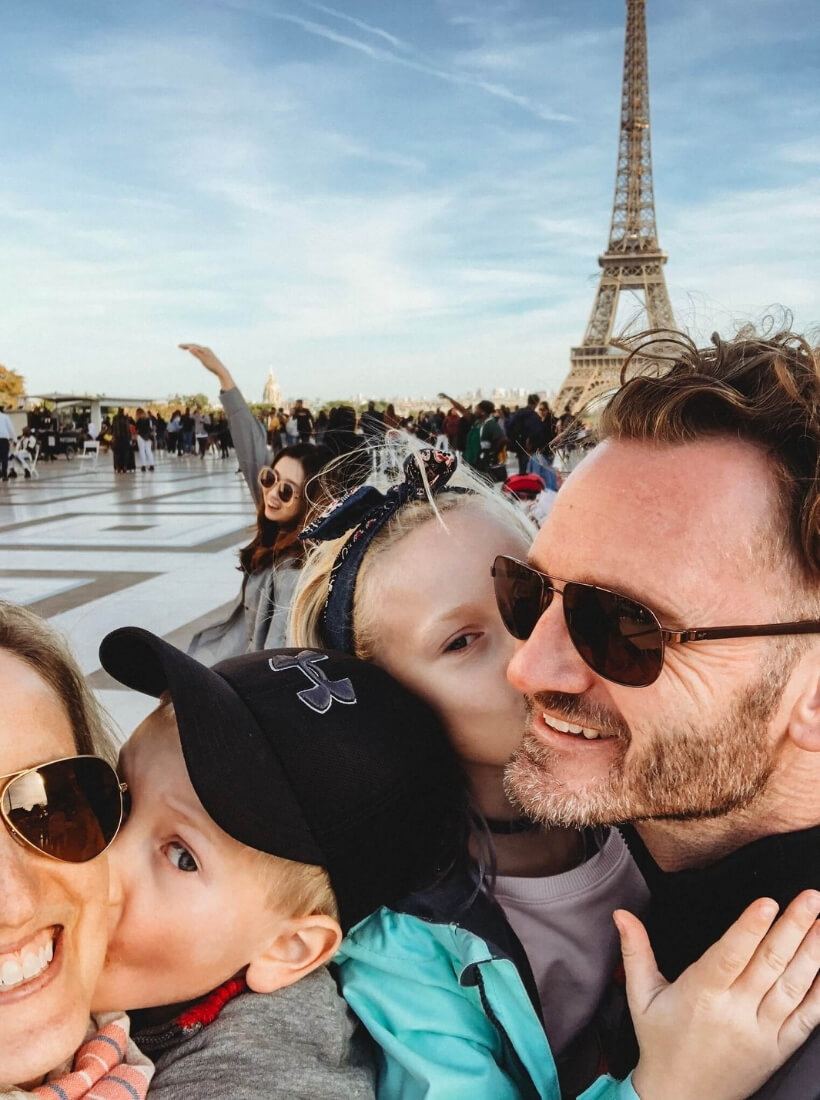 Jessica, her husband, son and daughter looking very happy and posing on the Trocadero in front of the Eiffel Tower: Great Activities in France for Families with Children episode