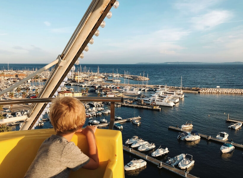 boy looking at a harbor in the Mediterranean: Great Destinations in France for Families Episode