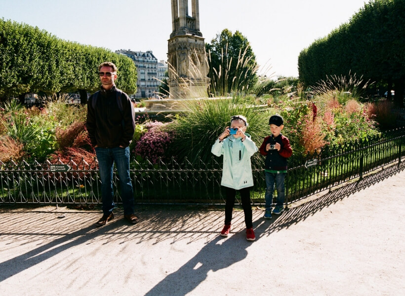Kids and father in Montpellier: both kids have a camera and taking photo. Great Destinations in France for Families Episode.