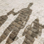 shadow of man and two children over cobblestone: Great Destinations in France for Families episode
