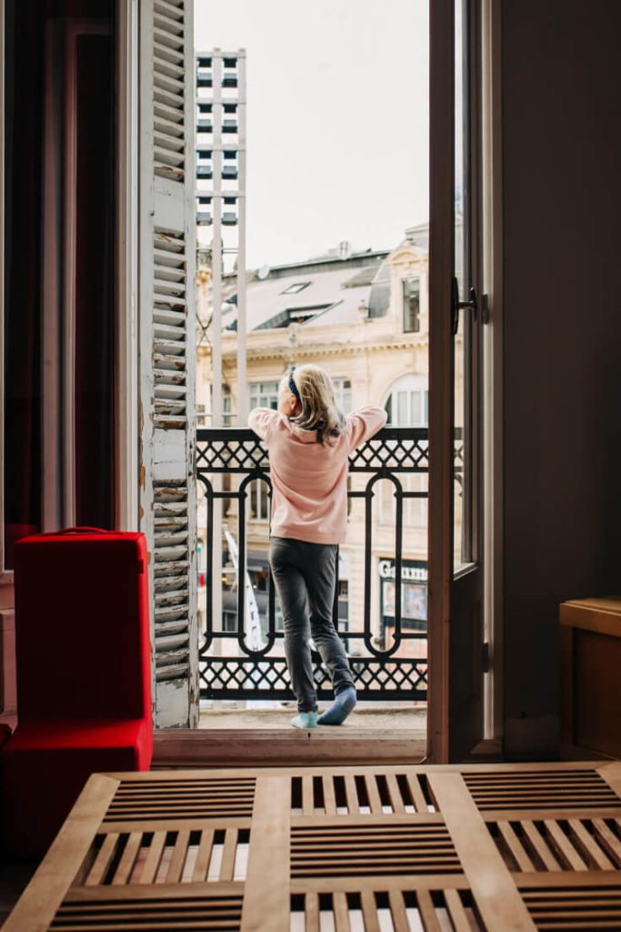 girl looking out of a window: vacation photos