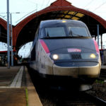 TGV train leaving a train station: public transportation in france episode