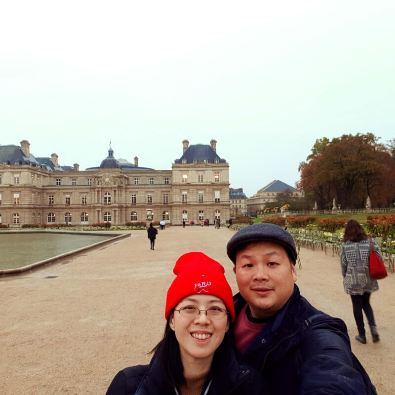 Eric and his wife at Versailles enjoying the gardens