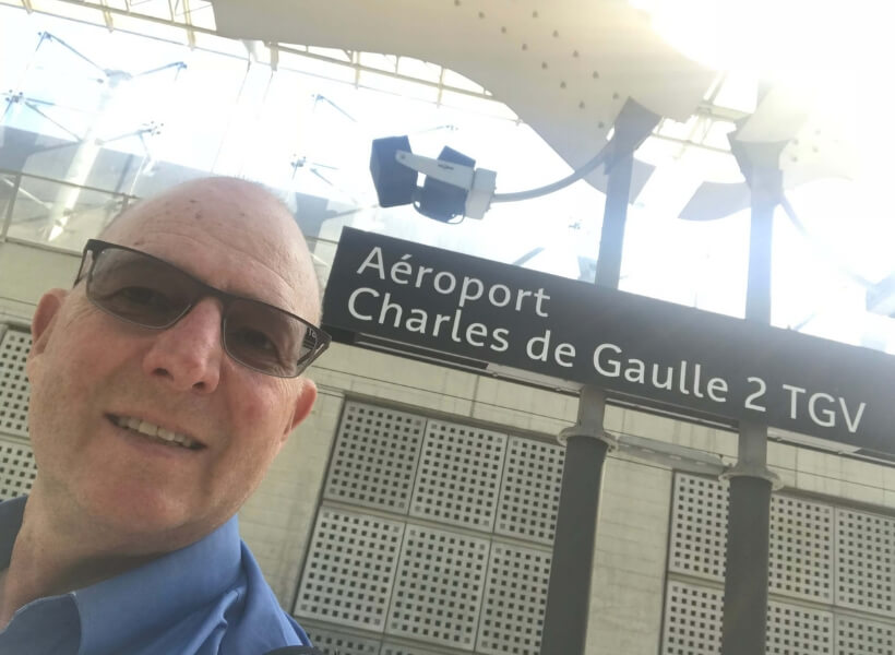 My guest Lachlan Cooke at the TGV station at Charles de Gaulle Airport: public transportation in france episode