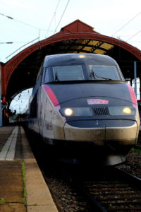 TGV train leaving a train station: public transportation in france episode
