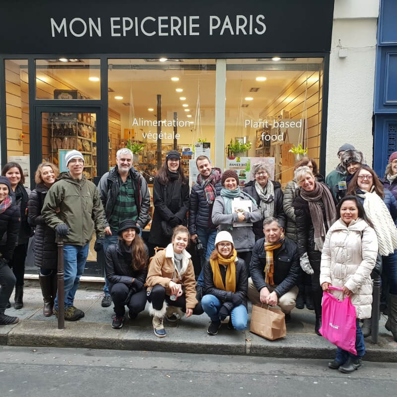 Brigdhe's goup in front of Mon Épicerie Paris: Vegans Visiting France episode