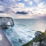cliff of Etretat in Normandy with dramatic sea and sky