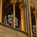 Stained-glass windows and stone columns inside Notre Dame before the fire of April 15, 2019