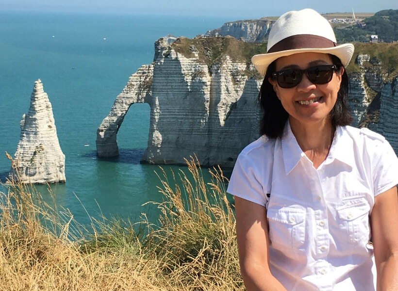 Janice in front of one of the portes in Etretat in Normandy