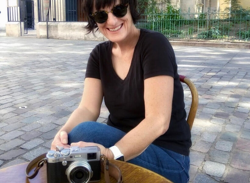 Valérie Jardin sitting at a café with her camera on the table: paris street photography episode