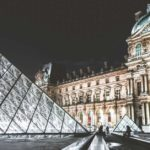 Outside of the Louvre at night: Visiting Paris with Teenagers Episode