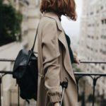 Woman walking in Paris and enjoying her audio tour