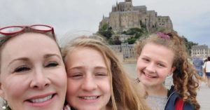 Kimberly and her daughters in front of the Mont Saint Michel: Women World Cup Trip Report episode