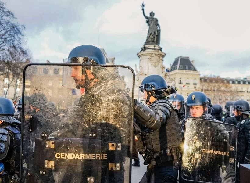 police in paris wearing riot gear