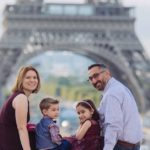 Michelle and family posing in front of the Eiffel Tower: Paris with Preschoolders episode