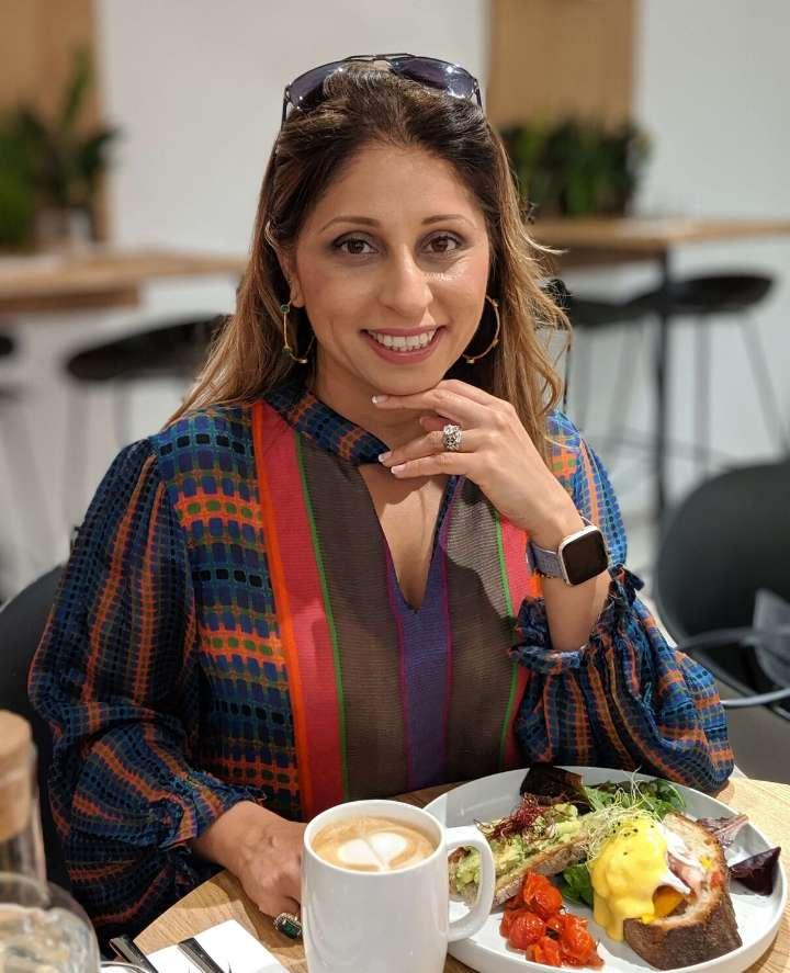 Deepa enjoying a meal at a restaurant