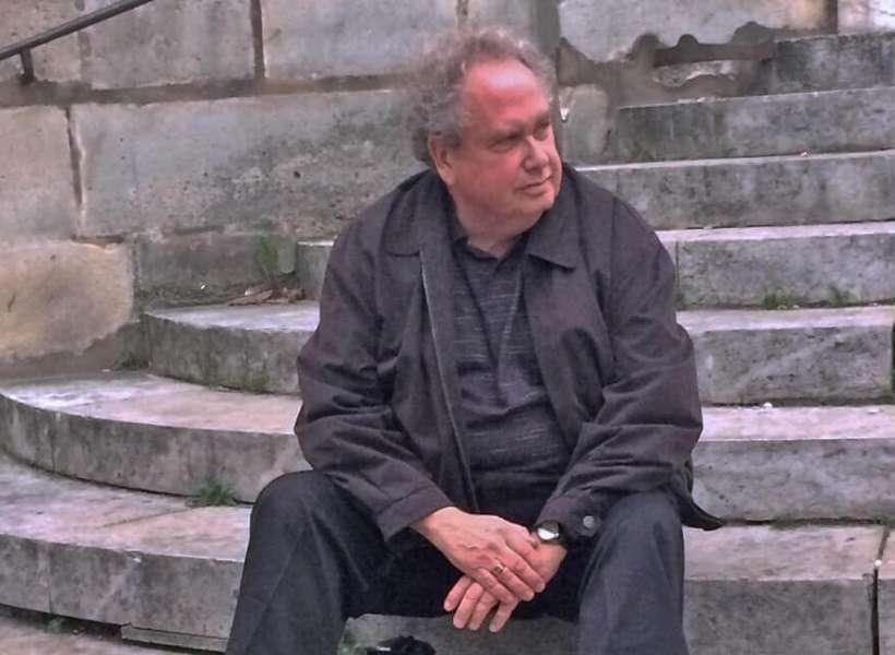 Phil sitting on the steps of Saint Etienne du Mont: Latin Quarter Episode