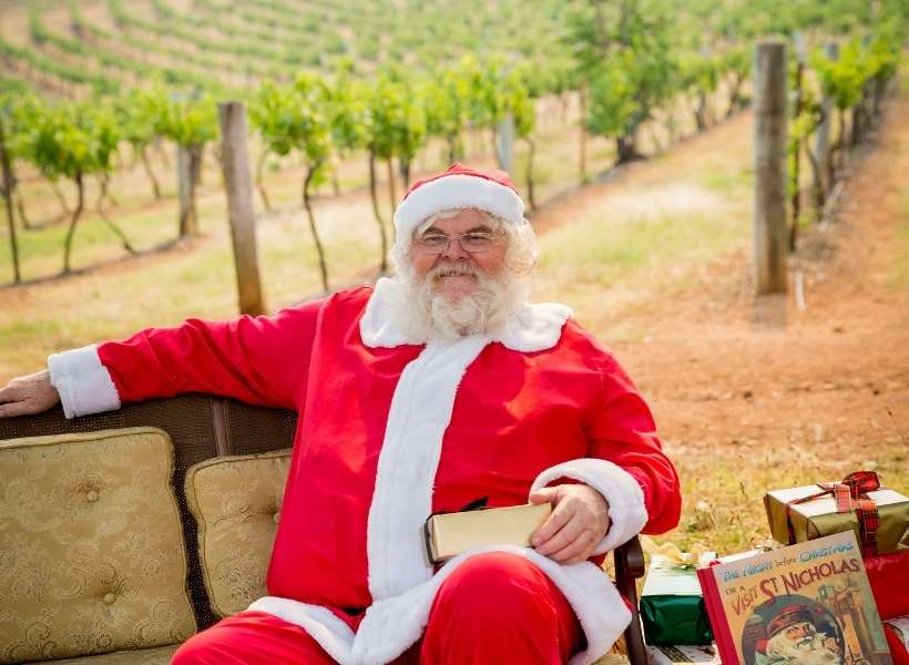 Santa sitting in front of a vineyard: Christmas with a French Flavor episode
