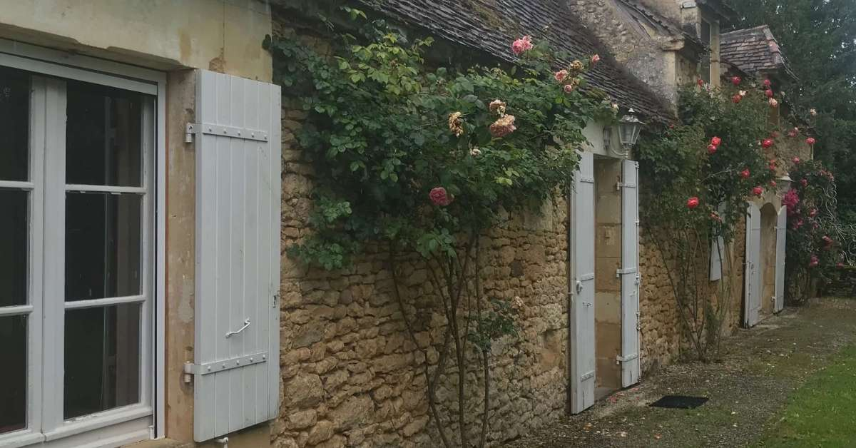 Old stone house with rose bushes: House Hunting in France episode