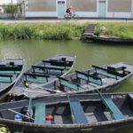 Boats tied to she side of a canal: Marais Poitevin Episode