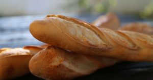 Baguettes on a table: Bread in France episode
