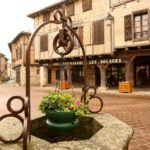 Water well and city square in the town of Castelnau de Montmiral: bastides in the southwest of France episode